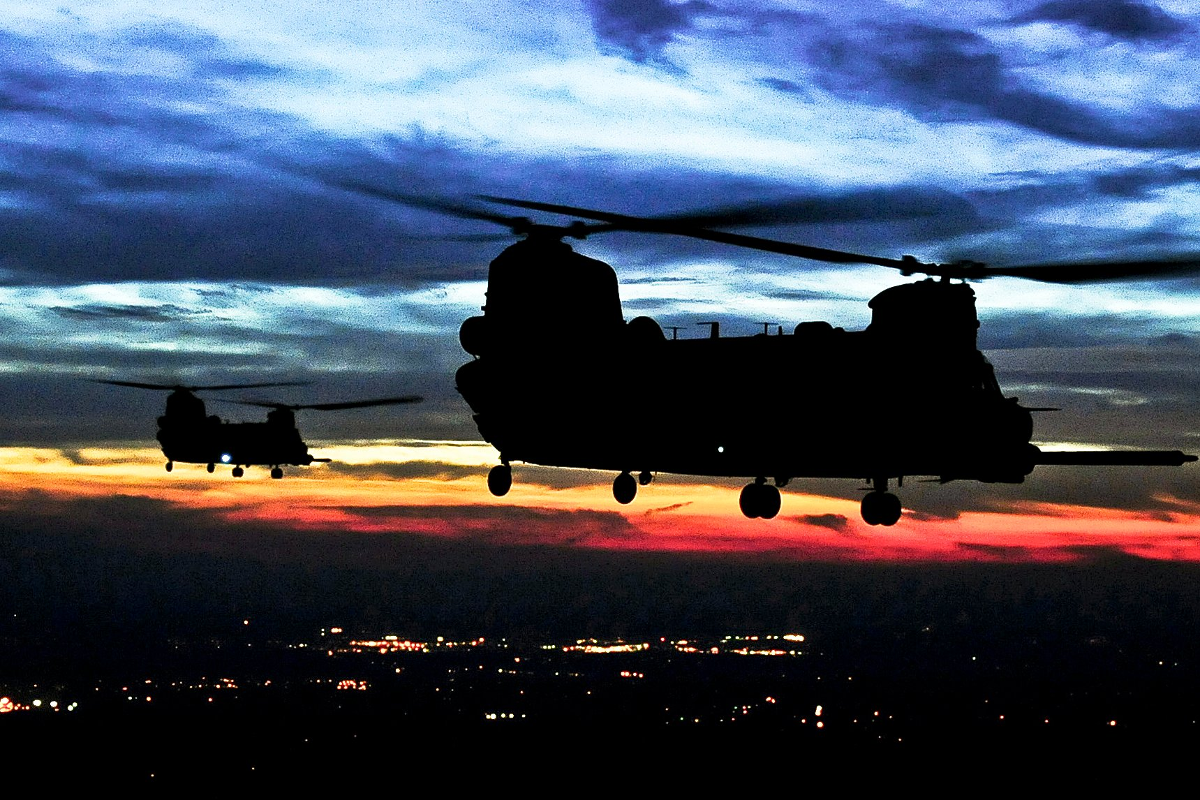 helicopters flying at dusk